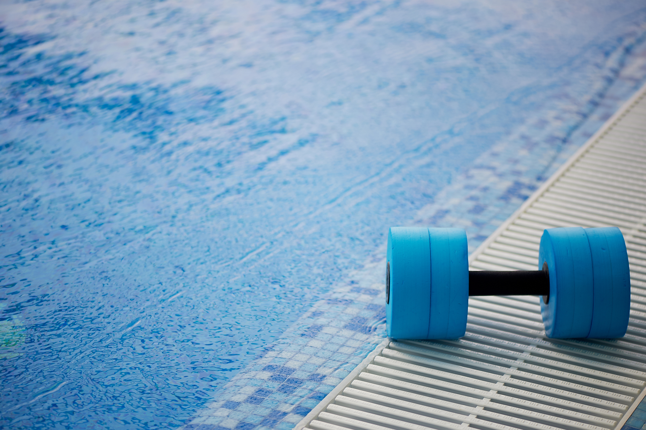 Dumbbell and swimming pool for aquatic exercise routine at home